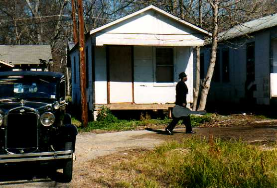 photo of Skip James reenactment from Ken Burns Documentary on The Blues, portions of which were filmed at the Blue Front Café in Bentonia, Mississippi